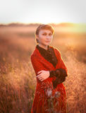 Beautiful red-haired girl in a field Royalty Free Stock Photos