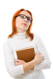 Beautiful red-haired girl in glasses with book. Stock Image