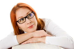 Beautiful red-haired girl in glasses with book Stock Photography