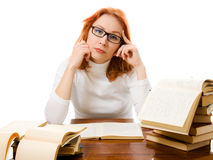 Beautiful red-haired girl in glasses with books. Stock Photos