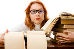 Beautiful red-haired girl in glasses with books. Stock Photo