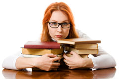 Beautiful red-haired girl in glasses with books Royalty Free Stock Image