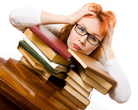 Beautiful red-haired girl in glasses with books Royalty Free Stock Images