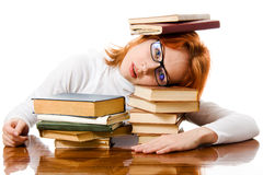 Beautiful red-haired girl in glasses with books Royalty Free Stock Photography