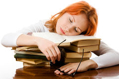 Beautiful red-haired girl in glasses with books Royalty Free Stock Photo