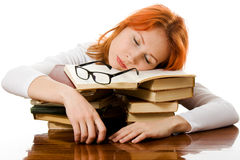 Beautiful red-haired girl in glasses with books. Stock Image