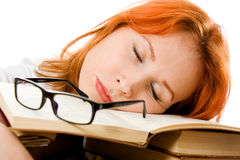 Beautiful red-haired girl in glasses with books Stock Photo