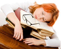 Beautiful red-haired girl in glasses with books Royalty Free Stock Photos