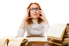 Beautiful red-haired girl in glasses reads book. Stock Photography