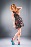 Beautiful red-haired girl on grey background Royalty Free Stock Photo