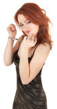 Beautiful red-haired girl in handcuffs Stock Photos