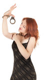 Beautiful red-haired girl in handcuffs Royalty Free Stock Photo