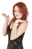Beautiful red-haired girl in handcuffs Stock Photo