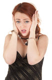 Beautiful red-haired girl in handcuffs Stock Image