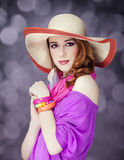 Beautiful red-haired girl in hat at bokeh background Royalty Free Stock Images