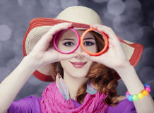 Beautiful red-haired girl in hat at bokeh background Stock Photography
