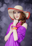 Beautiful red-haired girl in hat at bokeh background Stock Photos