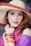 Beautiful red-haired girl in hat at bokeh background Stock Images