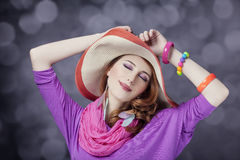 Beautiful red-haired girl in hat at bokeh background Royalty Free Stock Photo