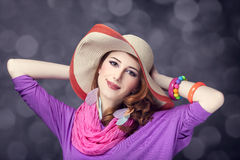 Beautiful red-haired girl in hat at bokeh background Royalty Free Stock Photography