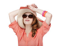 Beautiful red-haired girl in hat at white background Royalty Free Stock Images