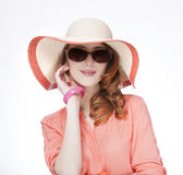 Beautiful red-haired girl in hat at white background Royalty Free Stock Photos