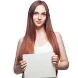 Beautiful red haired girl holding sign Stock Image