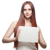 Beautiful red haired girl holding sign Royalty Free Stock Photos