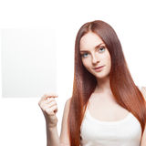 Beautiful red haired girl holding sign Stock Photos
