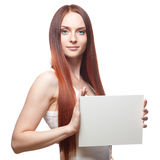 Beautiful red haired girl holding sign Stock Photography