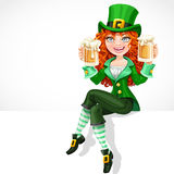 Beautiful red-haired girl leprechaun sitting on the banner Royalty Free Stock Images