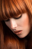 Beautiful red haired girl looking down portrait Royalty Free Stock Images