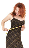 Beautiful red-haired girl with meter in hand Stock Photos