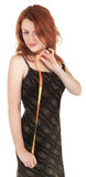 Beautiful red-haired girl with meter in hand Royalty Free Stock Photo