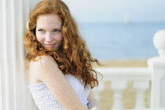 Beautiful red-haired girl near the sea Royalty Free Stock Photography