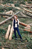 Beautiful red-haired girl in pine forest Stock Image