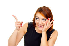 Beautiful red-haired girl points a finger Royalty Free Stock Photo