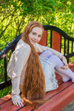 Beautiful red-haired girl Stock Photos