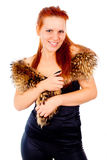 A beautiful red-haired girl posing with fur Stock Images