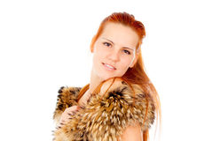 A beautiful red-haired girl posing with fur Royalty Free Stock Photo