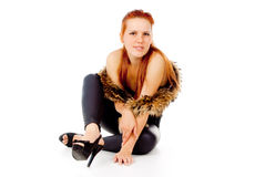 A beautiful red-haired girl posing with fur Stock Photo