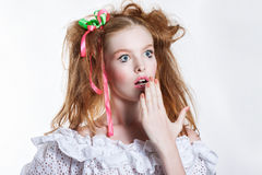 Beautiful red-haired girl with ribbons in her hair. Human emotions. Surprise Stock Images