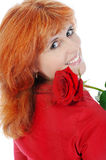 Beautiful red-haired girl with a rose. Royalty Free Stock Photos