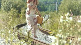 Girl with a suitcase on the railway tracks. stock video footage