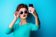 Woman making selfie Stock Images