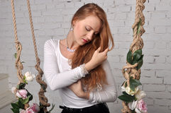 Beautiful red-haired girl Tilting his head in profile Royalty Free Stock Photos
