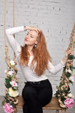 Beautiful red-haired girl Tilting his head in profile Stock Images
