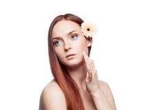 Beautiful red haired girl touching skin Royalty Free Stock Images