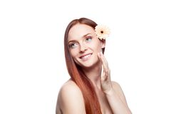 Beautiful red haired girl touching skin Royalty Free Stock Photography