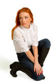 Beautiful red-haired girl in a white blouse Royalty Free Stock Photography
